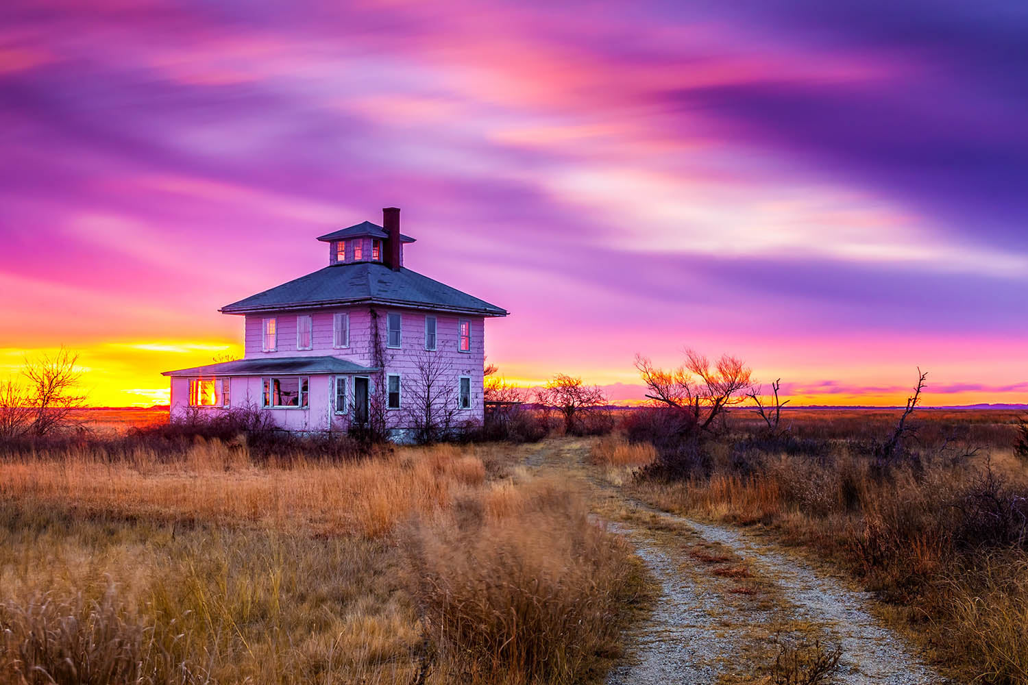 Landscape wall art photography of the iconic Plum Island pink house under a colorful long exposure sunrise