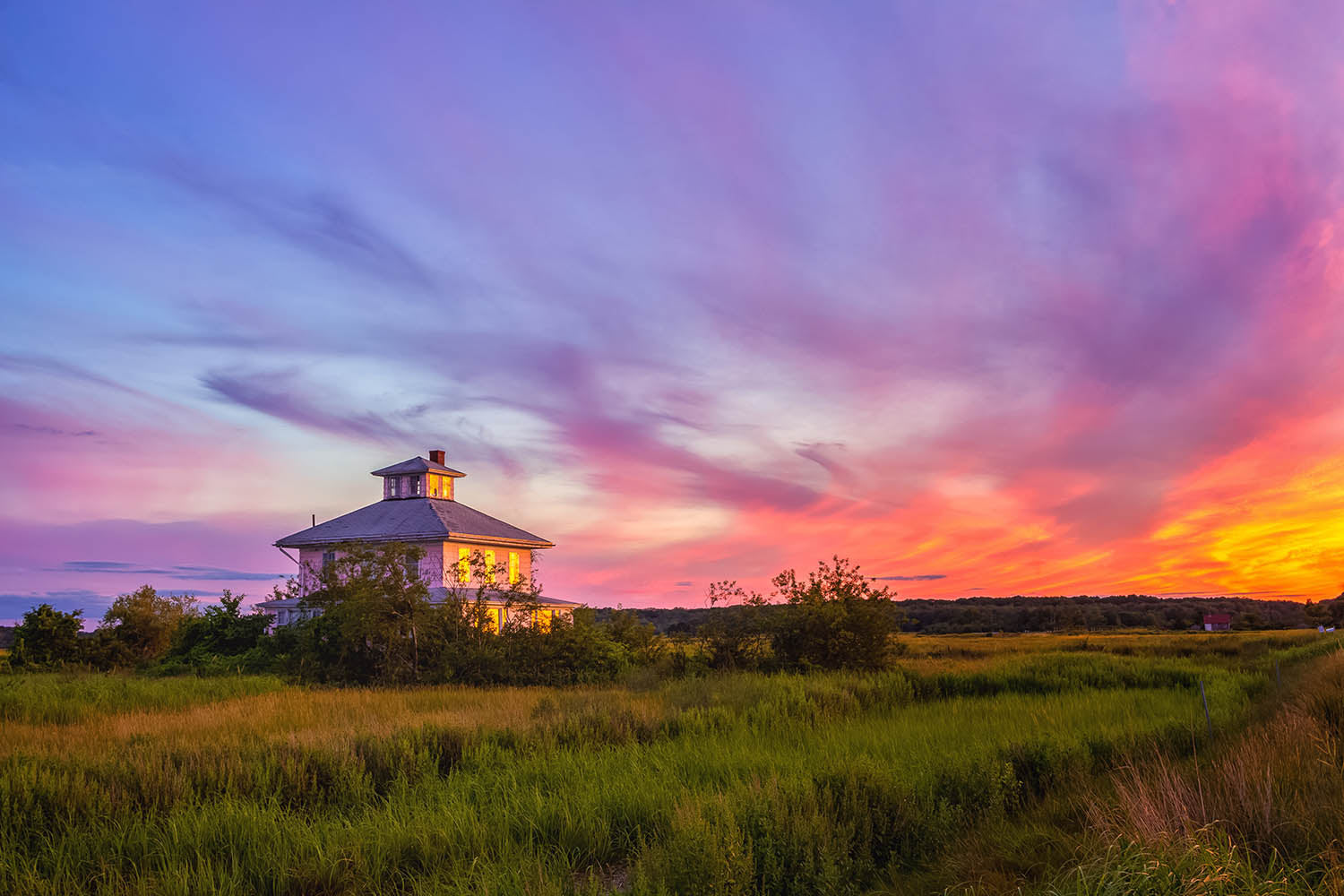 Landscape photograph of the Plum Island pink house at sunset in Newburyport, Massachusetts - by Jonathan Elcock