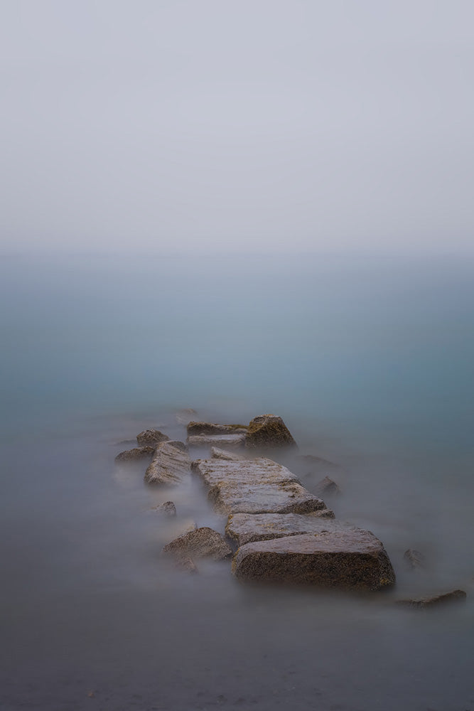Landscape photograph of fog covering the ocean from Revere Beach, Massachsuetts - by Jonathan Elcock