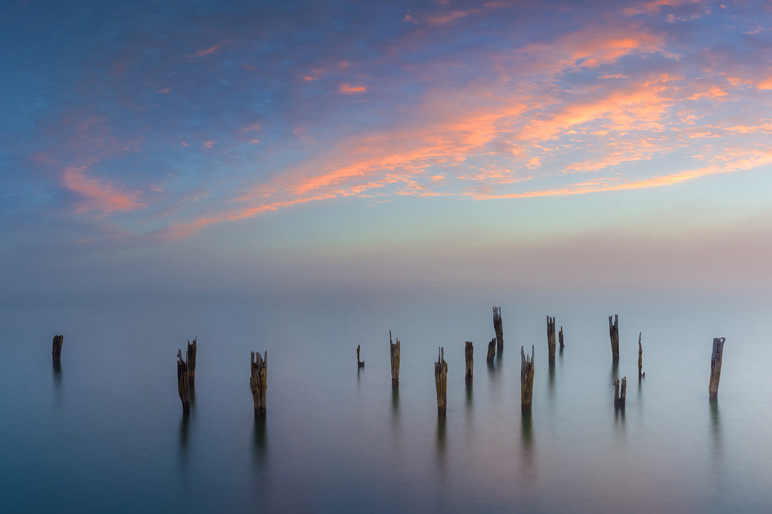 Landscape wall art photography of a foggy sunset over abandoned pilings in the Boston Harbor