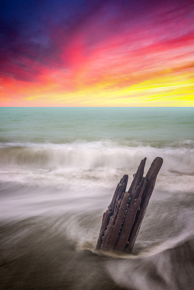 Landscape wall art photography of sunset burning over the rushing tide along the Massachusetts coast