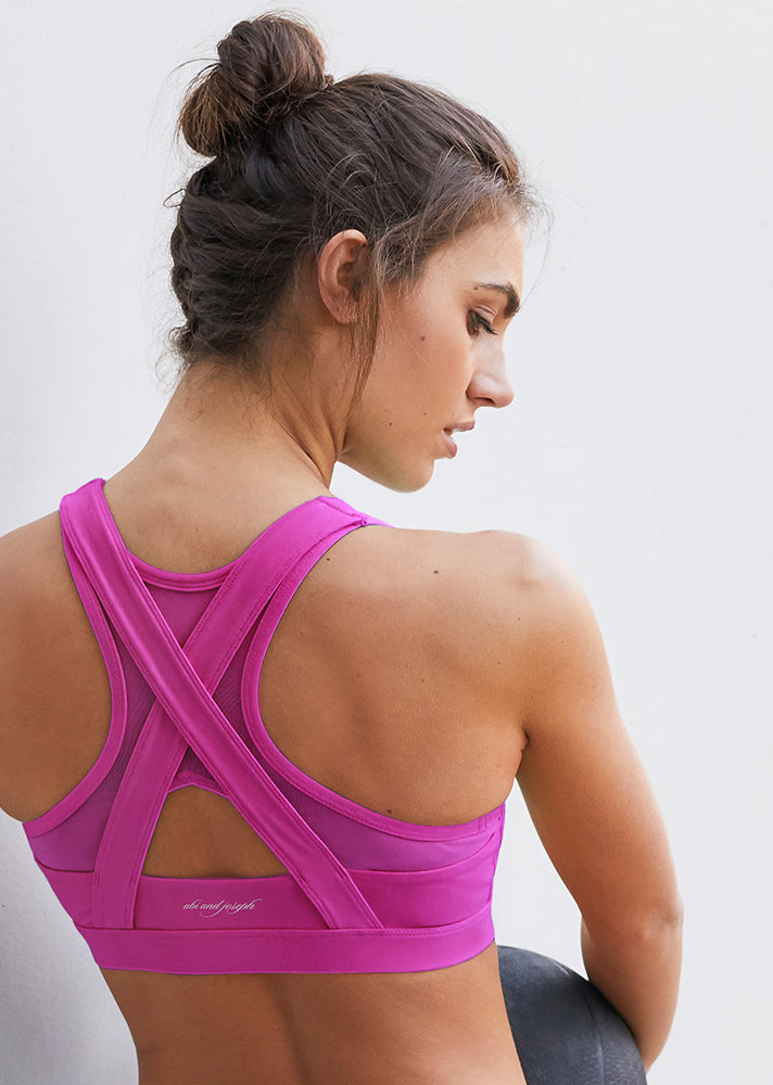 Woman wearing a PURPLE ORCHID LEO HI-TECH SPORTS BRA back view