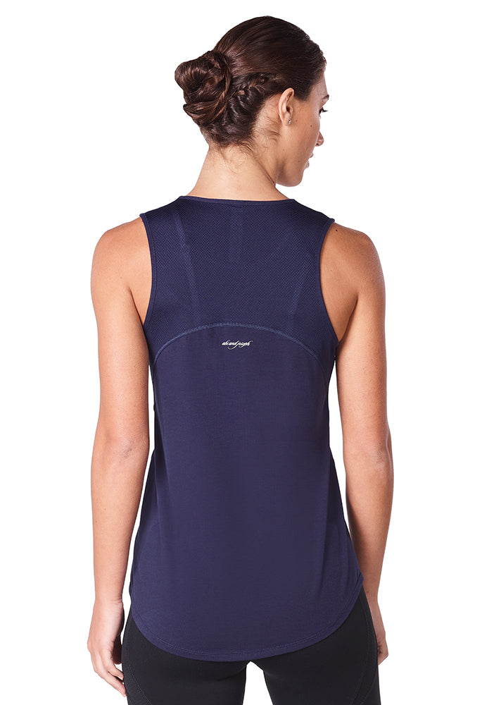 Lady wearing a navy jazmin sports tank top back view