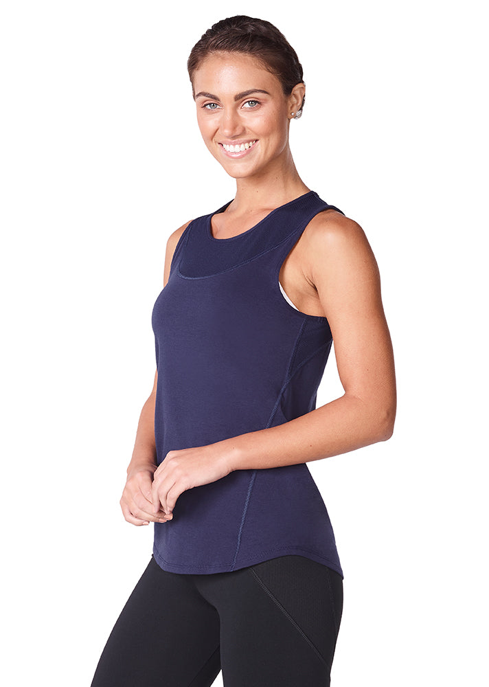 Lady wearing a navy jazmin sports tank top