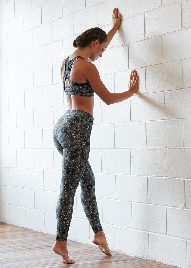 woman wearing abi and joseph geometrica gym leggings and sports crop back view