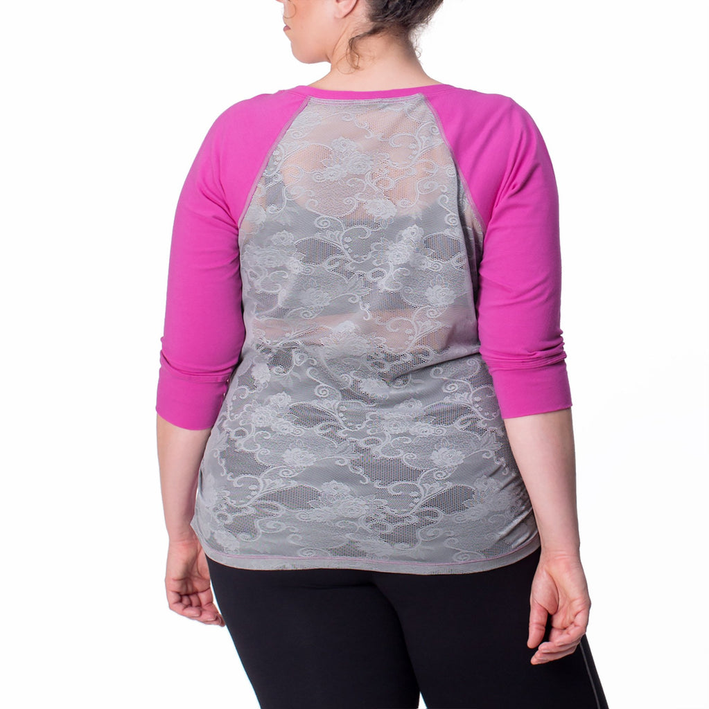 Women wearing a pink and grey activewear top back view