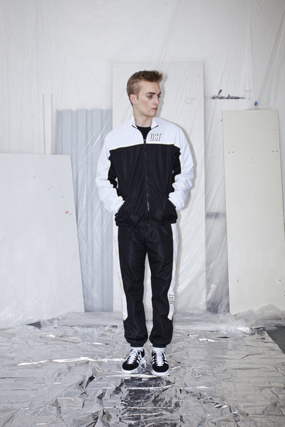 OST konzept Spring Summer 2017 black gold and white tracksuit jacket look1. Eastern european progressive trash fashion.