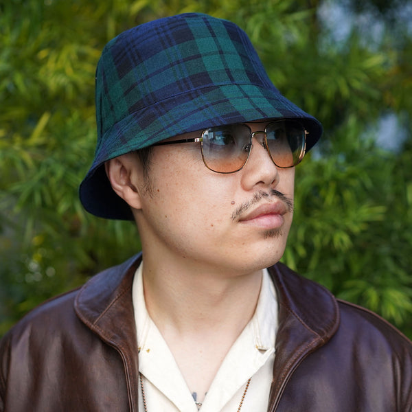 Joyride Reversible Bucket Hat in E. Thomas Black Watch Plaid Wool/Orta Anadolu Deep Indigo Chambray