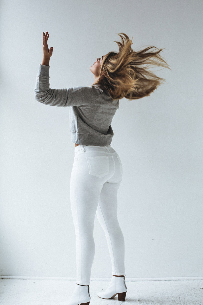 CocoCooper Jeans Model with arms raised