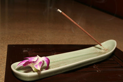 Smoke rising from a stick of incense
