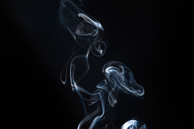 Wisps of smoke on a black background