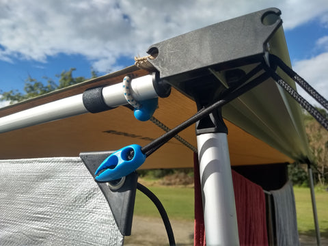 The Shockloc Strap is the easiest way to attach tarps / shade / privacy screens to caravan / 4wd awnings