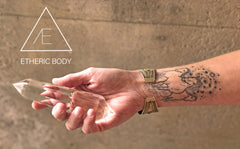 A link to Etheric Body™ by Halo Auragraphic. Photo of a hand holding a crystal.