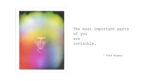 "This is an image of an aura photo by Halo Auragraphic of a man with a rainbow aura and next to his portrait is a quote that says ""The most important parts of you are invisible"", the quote is by Fred Rogers."