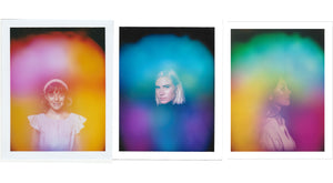 Three aura photos by Halo Auragraphic, image left is a young girl with a pink and yellow aura, image center is a woman with a green and violet aura, image right is a girl with a green, yellow and magenta aura.