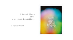 "This is an aura photo by Halo Auragraphic of a girl with a rainbow aura and next to her portrait is a quote by poet Nayyirah Waheed, that says ""I found flaws and they were beautiful."""