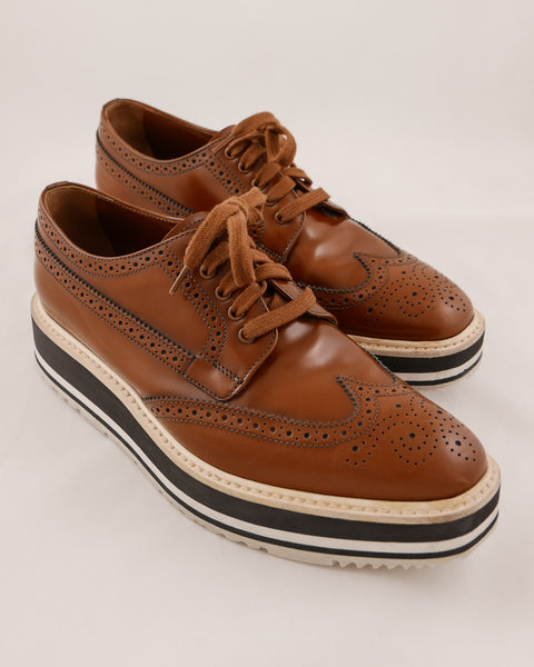 Prada Leather Wingtip Platform Shoes