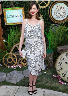 Anne Hathaway wearing Anya Hindmarch crisp packet clutch available at iBagzy bag rental Northern Ireland