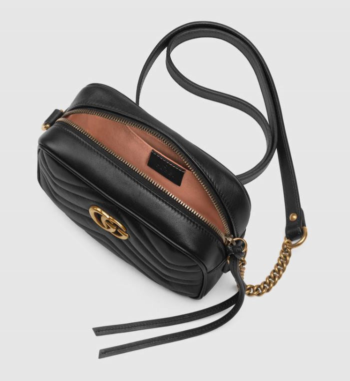 Black leather Gucci Marmont shulder bag with double G branding to rent at iBagzy