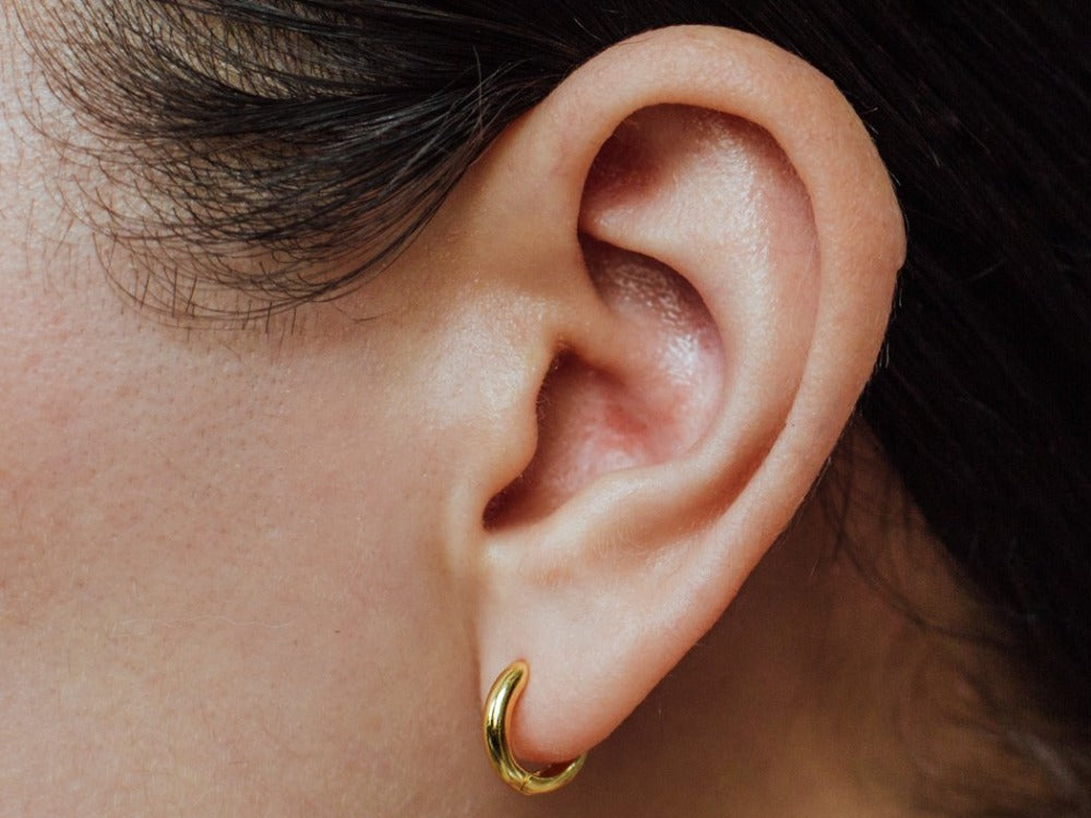 Tiny Huggie Earrings in 14k Gold