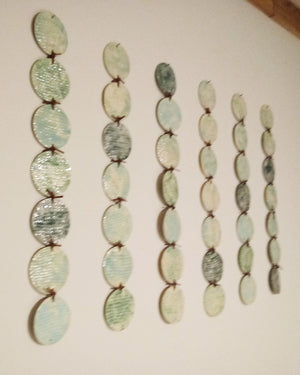 Porcelain Wall Sculpture- 42 Carved Discs with Leather