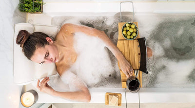 Women practising self-care with a modern expandable bath tray and a bathtub pillow for tub.