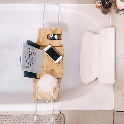Bath tray and pillow for a relaxing bubble bath. Luxury self-care gifts to pamper your loved ones.