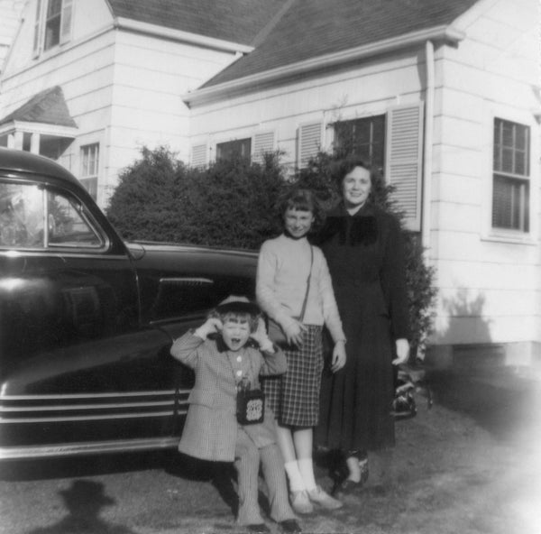 That's me making the funny face, then comes my sister Nancy and our mom.   We are in front of our home at 52 Rhoda Avenue.