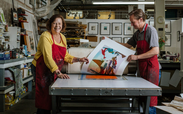 Jane Braley and Mark Lunning  working at the printing press at Open Press Studio in Denver, CO
