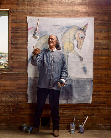 Ian Ratowsky, Multi-Media Artist flipping paint brushes in his Longmont, CO studio