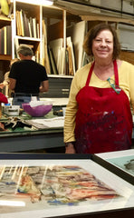 Jane Shepherd Braley stands at a table at Open Studio in Denver CO