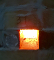 Peep Hole in wood fired kiln ablaze