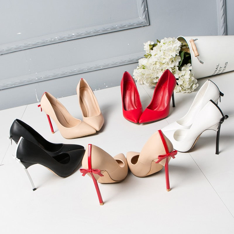 Back bow pointed toe heels