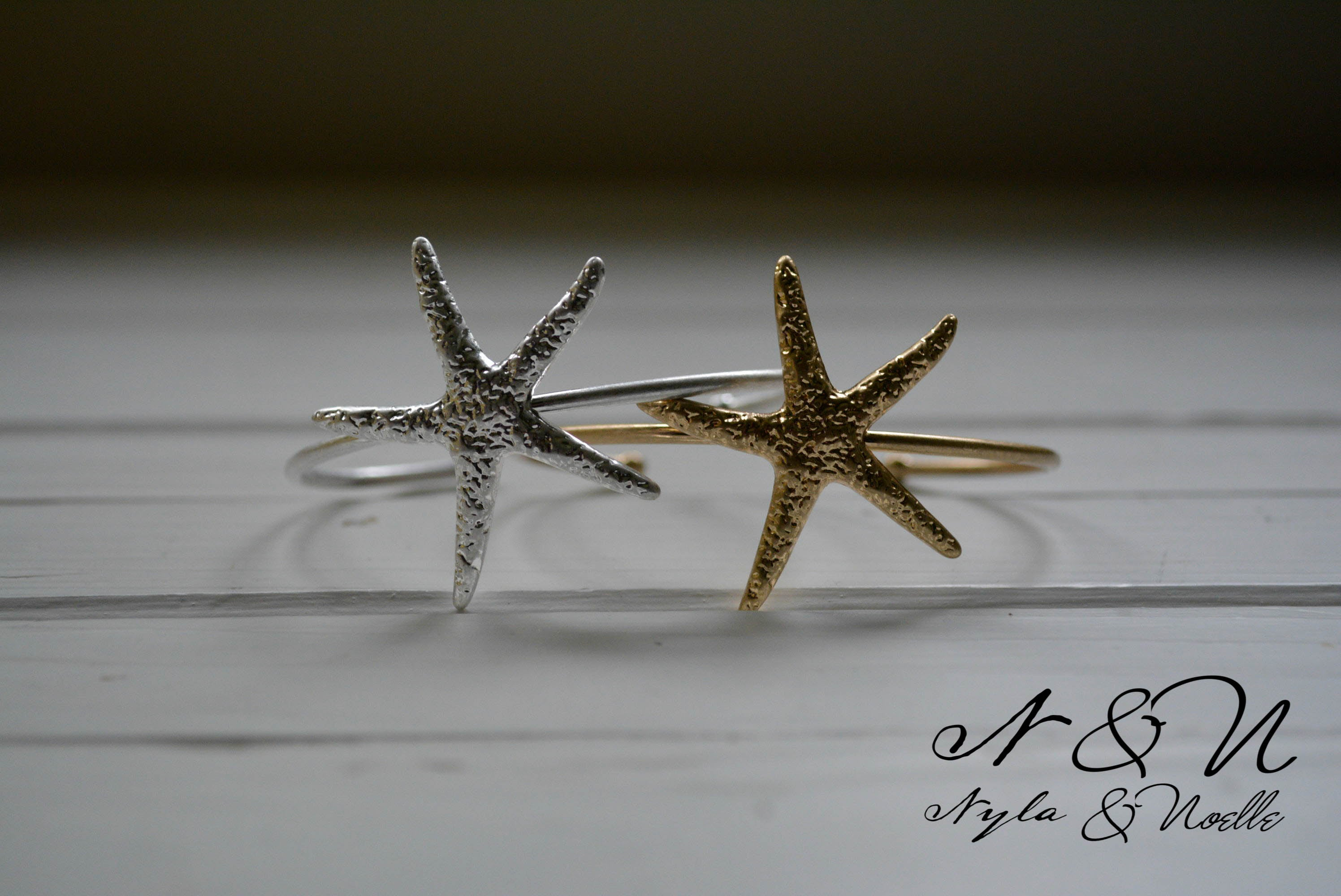 A STAR IS BORN -  Gold Tone Starfish Cuff