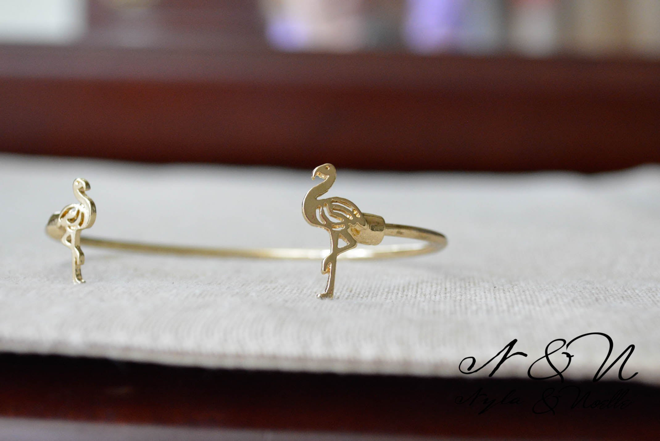 FLAMINGO STRUT -  Gold Tone Open Wire Bangle