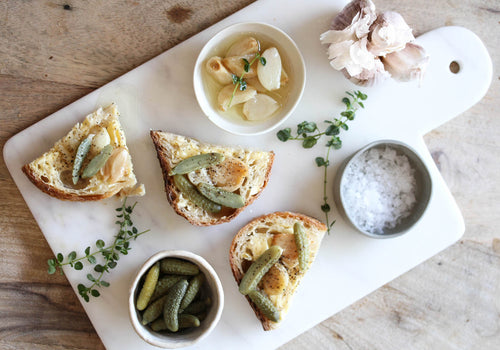 Confit Garlic on Sourdough with Thyme and Cornichons
