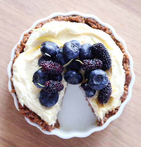 Slice missing from mascarpone and blueberry tart