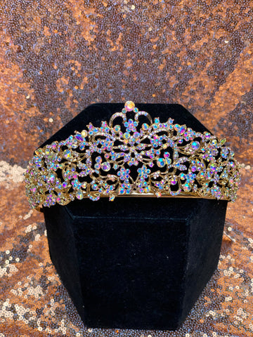 Gold crown with iridescent colored stones