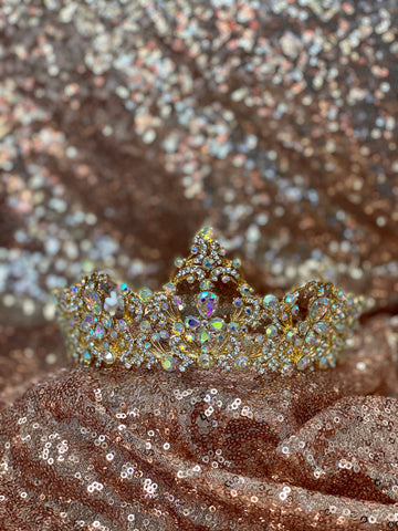 Gold crown with iridescent stones