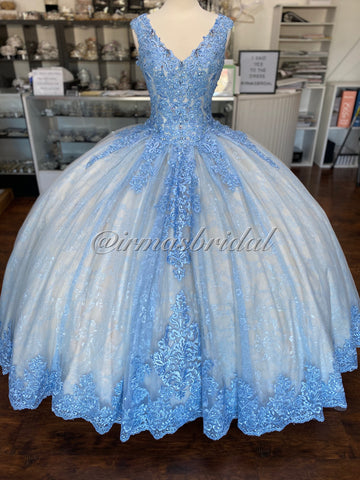 Blue and champagne colored gown with layers of lace and glitter tulle in both colors