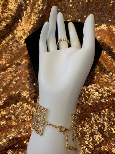 Gold bracelet with attached ring