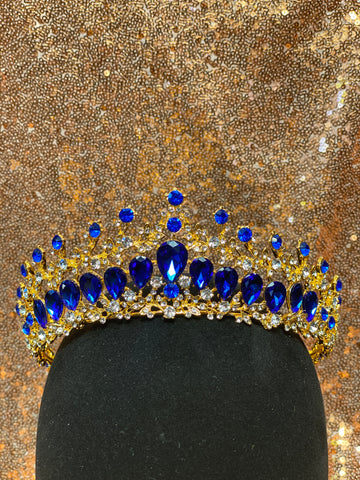 Gold crown with royal blue stones