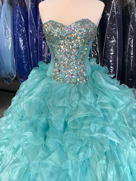 Aqua colored ruffle skirt gown with a corset back.