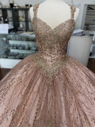 Beautiful Rose Gold Quinceañera dress with gold details