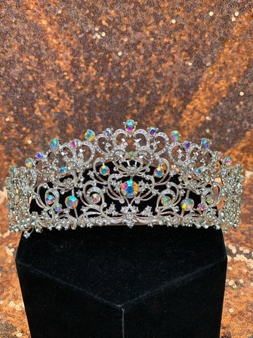 Tall silver crown with iridescent stones