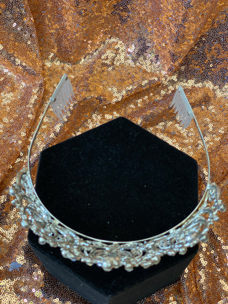 Silver crown with clear stones