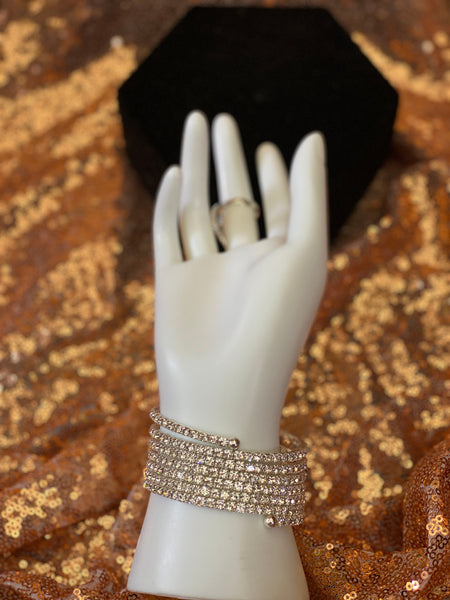 Silver hand bracelet with ring attached