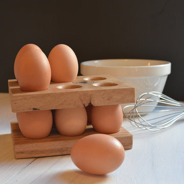 two wooden egg stackers