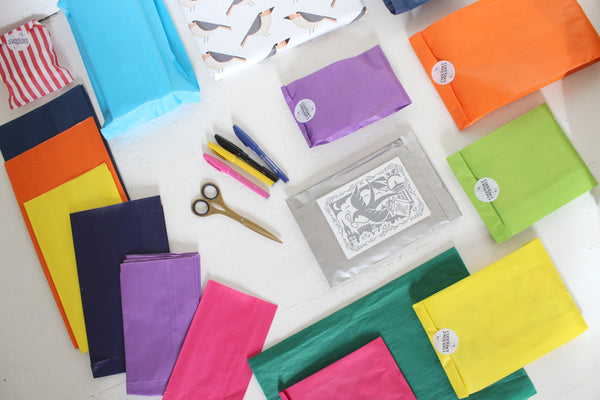 colourful paper bags, scissors and a hand written card