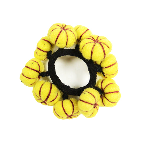 Handmade felt hair tie from wool pompons yellow